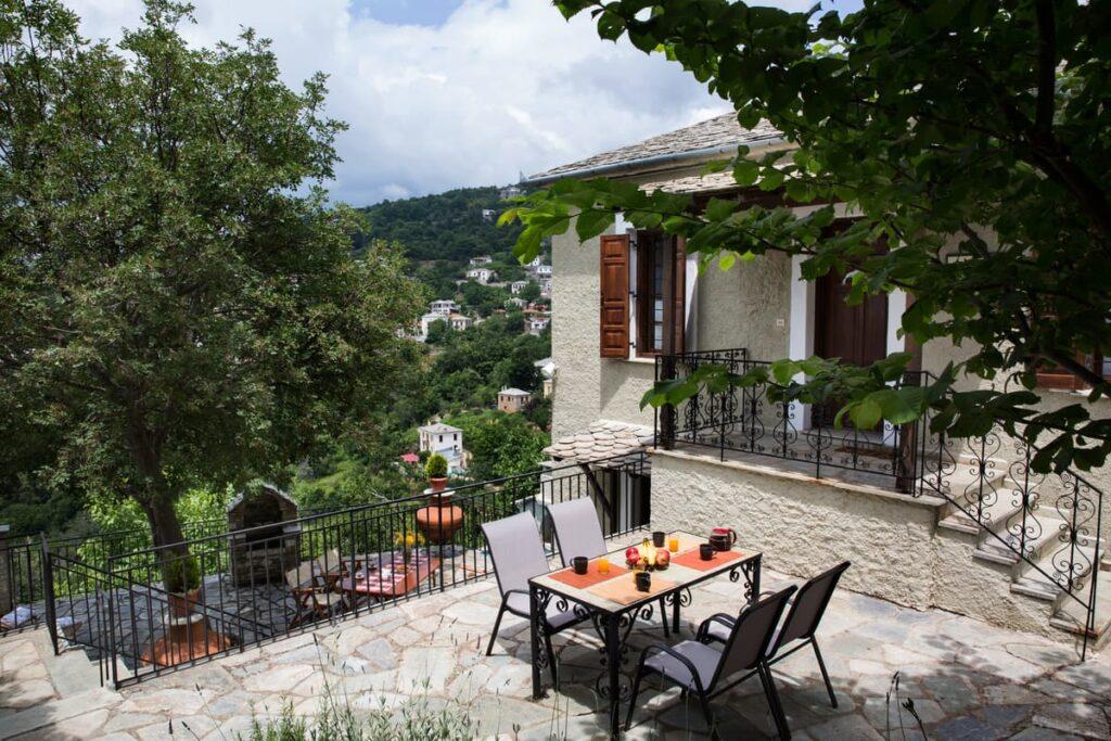 a garden of a villa with tables